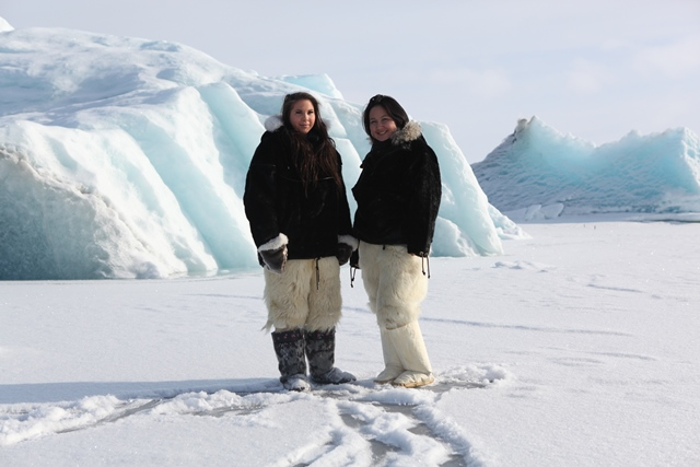Pipaluk and Sara on the sea ice with polar bear pants